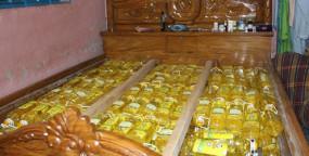 ব্যবসায়ীর বাড়ির খাটে মিললো 'টিসিবির তেল'